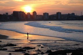 Panorama of the evening beach in Gijon, Spain