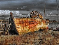 abandoned old ship on shore