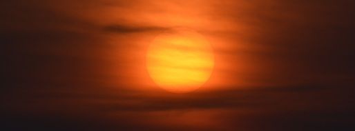 Sun at sunset in a light haze
