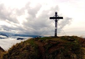 cross on top in the alps