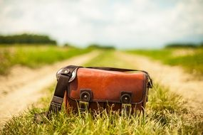 leather handbag on a path