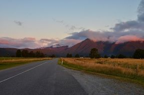 free road to mountains, scenery sunset, new zealand