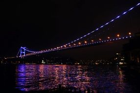 illuminated bridge at night in Istanbul