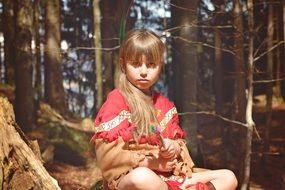 child girl in the forest