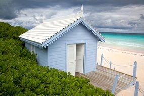 blue house on the coast in the Bahamas