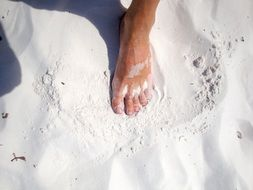foot on white sand