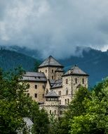 beautiful view of the big castle in the forest and near the mountains in Austria