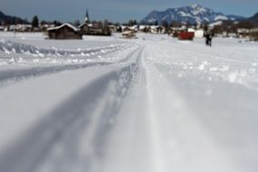 ski trails on glossy snow at mountain village