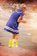 girl in yellow rubber boots