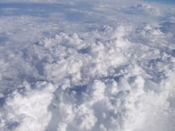 white fluffy clouds in the atmosphere