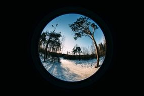View through the lens on a snowy landscape