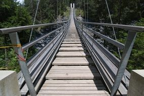 mountain suspension bridge hike trek view