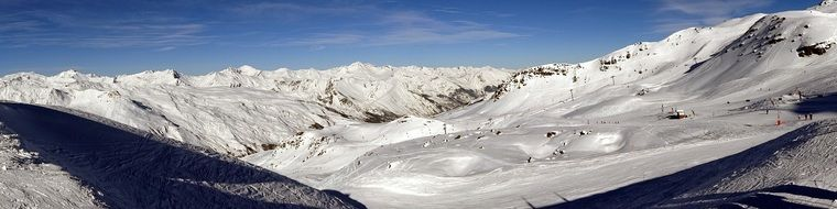 panoramic view of a ski resort in the alps