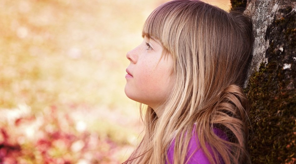 human child girl face blond near tree
