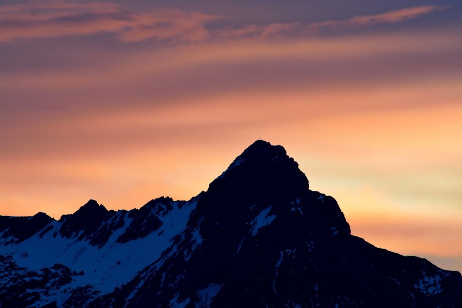snow mountain peak orange sky view