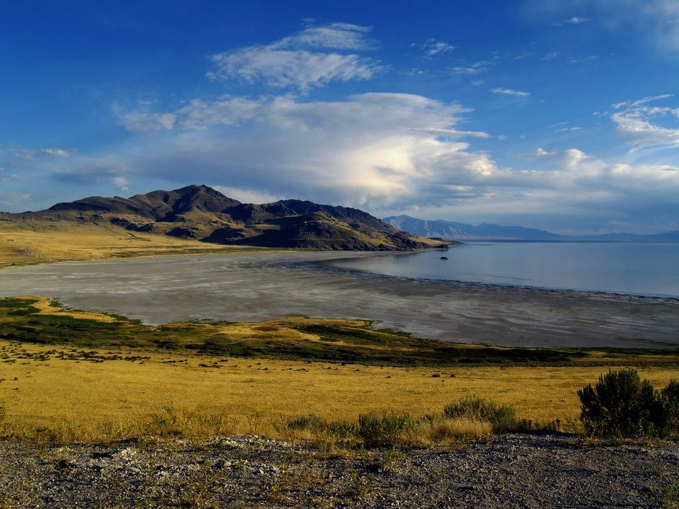 Landscape of beautiful Great Salt Lake among the colorful fields in Utah