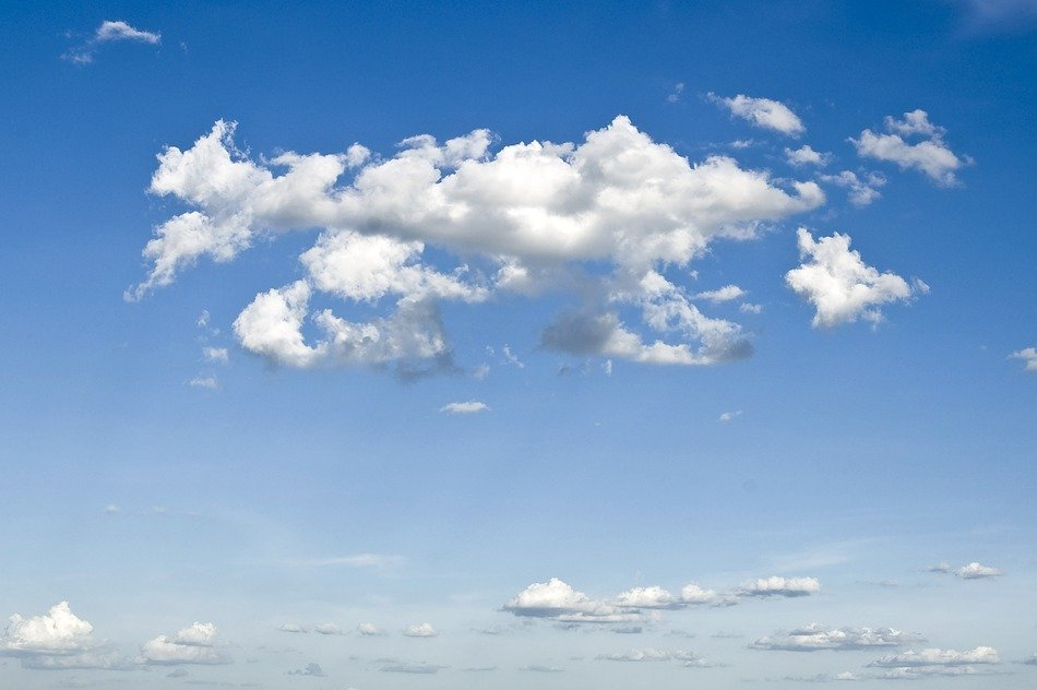 Beautiful white clouds in blue gradient sky