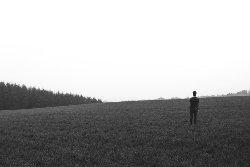 lonely man on the empty field
