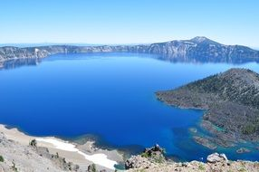 crater lake with blue water peaceful scene