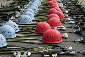 red and blue climbing helmets