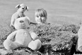 child girl face stuffed animals black and white view
