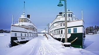two ships in the harbor amidst the ice in Ontario, Canada