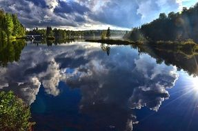 reflection of the clouds in the calm lake in Quebec