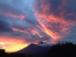 blue and pink clouds over the volcano in Guatemala