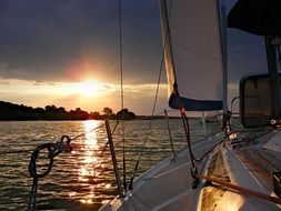 sailboat water sunset vacation