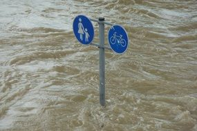 high water and road sign