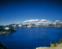 panorama of bright blue crater lake in oregon