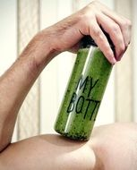 bottle with green smoothie