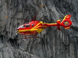 rescue helicopter on a background of rocks