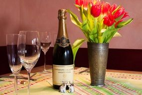 tulips, glasses, rabbit figurines and champagne cremant de loire marqis de neausei brut