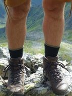 mountaineering shoes on legs
