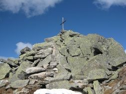cross on stone slabs in the Alps