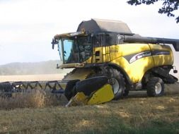 combine for harvesting grain on the field