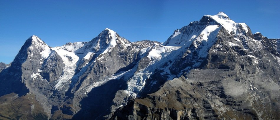 panoramic view of the eiger mountain peak on a sunny day