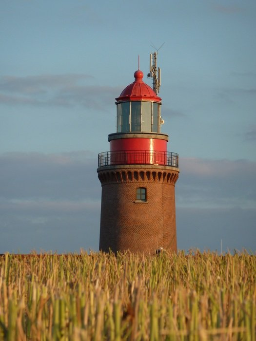 red lighthouse on the coast of the Baltic Sea