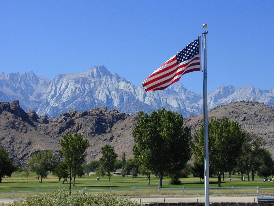 american flag on pole at rocky mountains, spain, sierra nevada