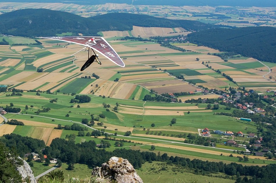 hang glider flies over the mountains