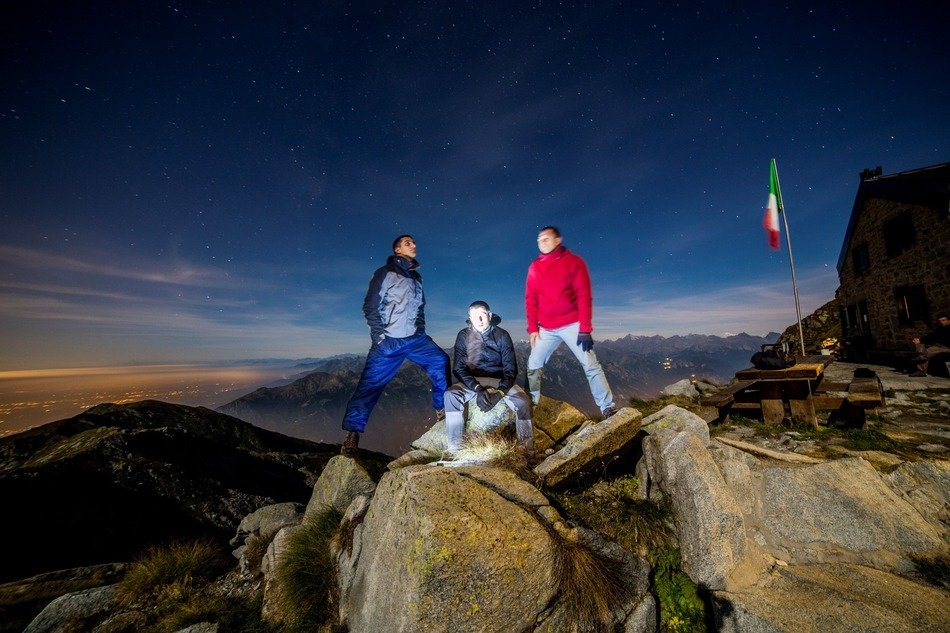 men at night on top of the mountain