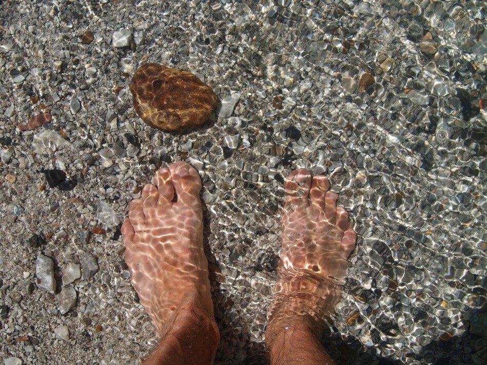 feet in the crystal clear water
