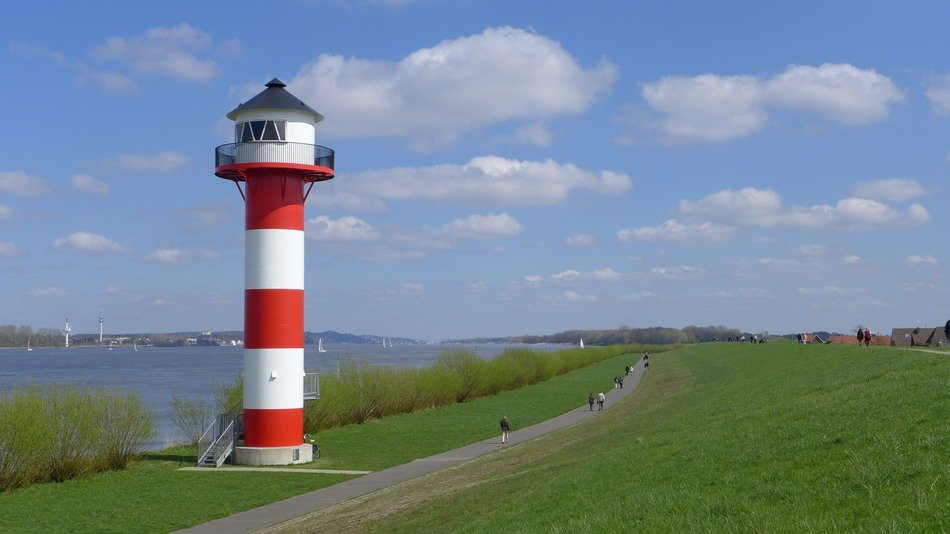 striped lighthouse on the banks of the river Elb