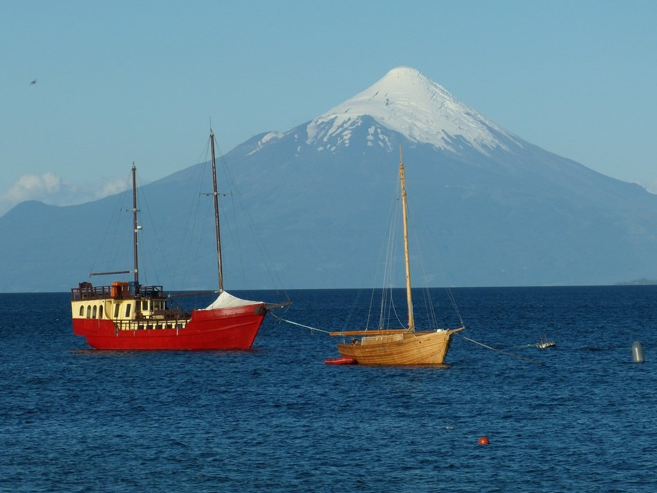 sailing ship on the background of a volcano in chile