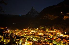 Amazing cityscape night bright lights Mountain aback
