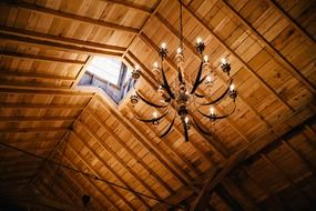 chandelier on an wood ceiling