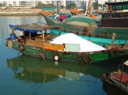 boat with the goods at the harbor in Haikou, China