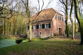 Old brick house in a autumn forest
