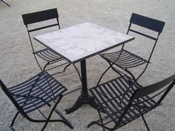 table with chairs in the street